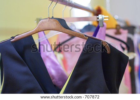 Designer clothes lined up in store - stock photo