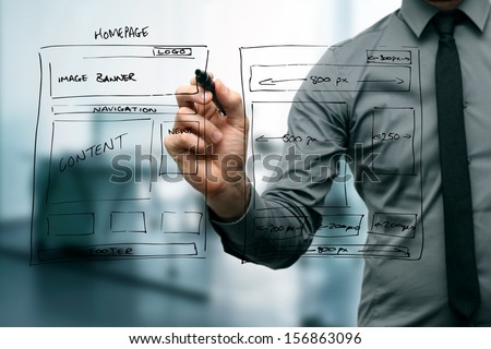 designer drawing website development wireframe - stock photo