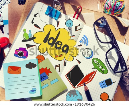 Designer's Table with Notes about Ideas and Tools - stock photo