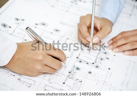 Designers discussing on drawing plan - stock photo