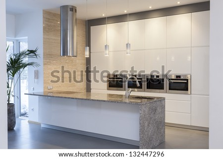Designers interior - Kitchen in a minimalist house interior - stock photo