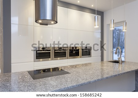 Designers interior - kitchen with white shelves - stock photo