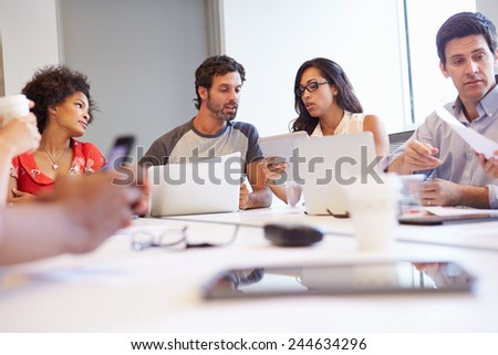 Designers Meeting To Discuss New Ideas - stock photo