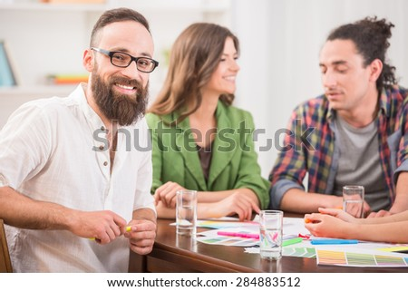 Designers meeting to discuss new ideas at office. Team work. - stock photo