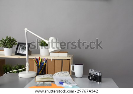 Designers table with camera and tools, cup