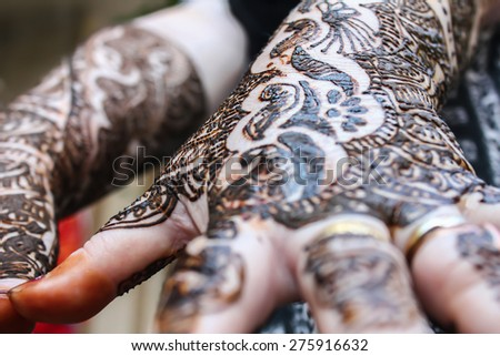 designing henna is applied to the hands of a hindu bride - stock photo