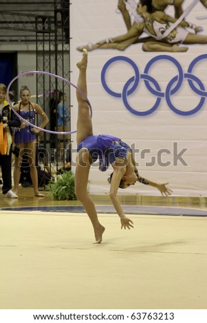 DESIO, ITALY - OCTOBER 23: Federica Febbo performs rhythmic gymnastics at the first round of the A1 Italian Championship on October 23, 2010 in Desio, Italy. - stock photo