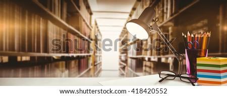 desk against close up of a bookshelf - stock photo