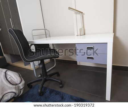 Desk and chair in childrens bedroom area of furniture show home