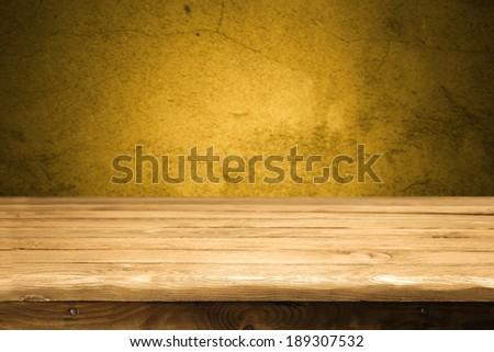 desk and orange wall  - stock photo