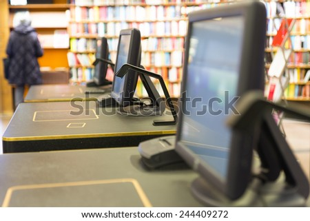 desk for borrowing or returning books in public library - stock photo