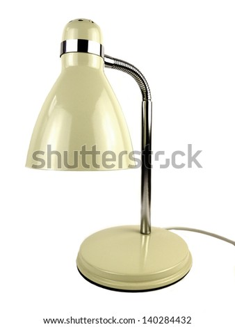 Desk lamp on a white background with cream enamel and chrome finish. - stock photo