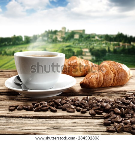 desk of coffee cup and landscape  - stock photo