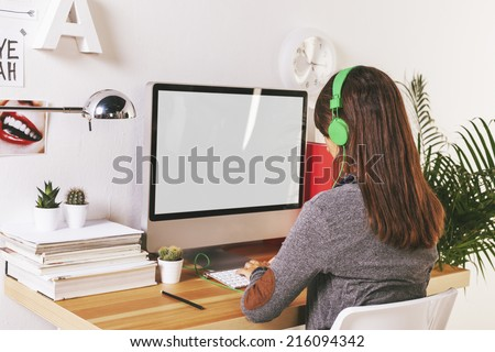 Desk of creative worker. /  Young creative woman working at office.  - stock photo