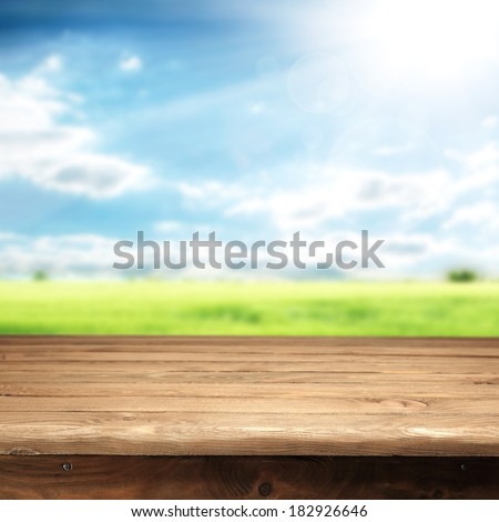 desk of empty space blue sky sunset and green grass  - stock photo
