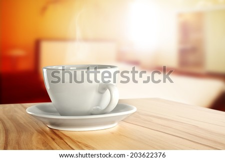 desk of furniture with coffee cup and window of sun light  - stock photo