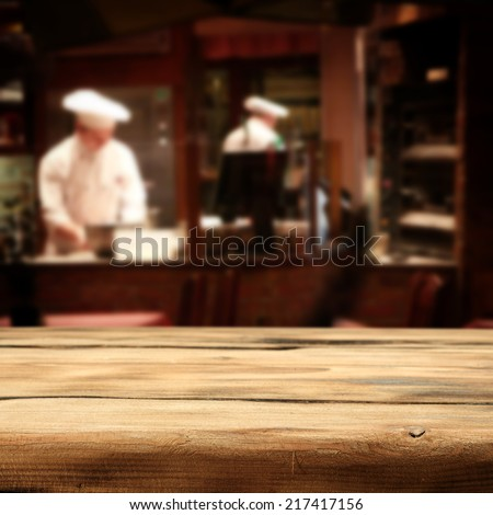 desk of wood place and cook men  - stock photo
