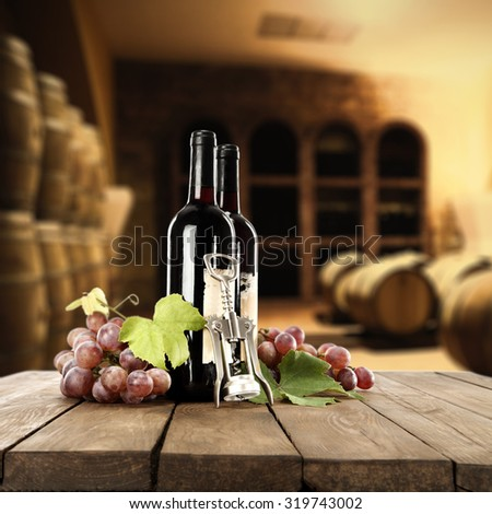 desk of wood wine and fruits in room of barrels  - stock photo