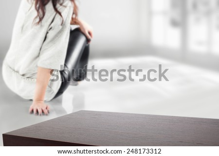 desk space and woman on the floor and window