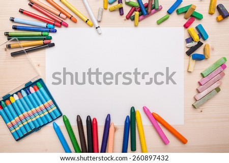 Desk with different painting objects on it - stock photo