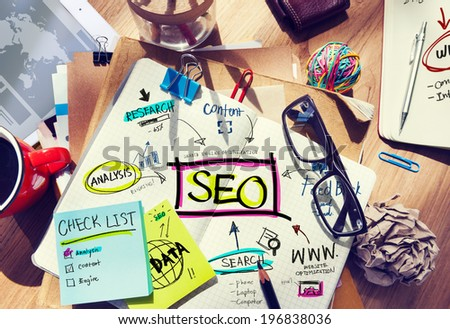 Desk with Notes About SEO - stock photo