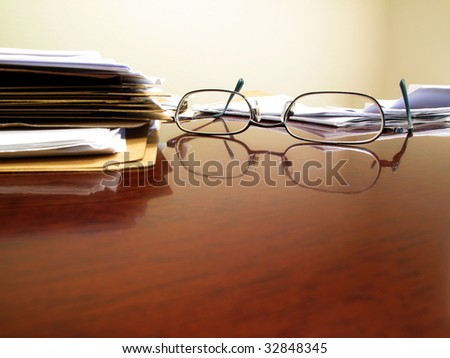Desk with papers and glasses