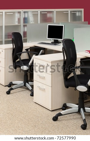 desks and chairs in a modern office - stock photo