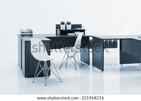 desks and chairs with reflection on white background - stock photo