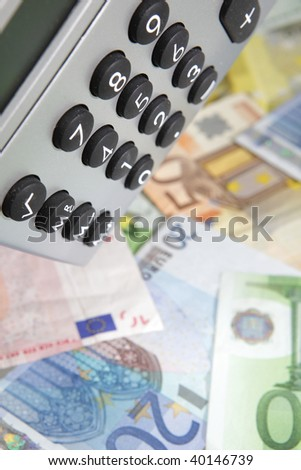 desktop calculator, closeup with euro currency - stock photo