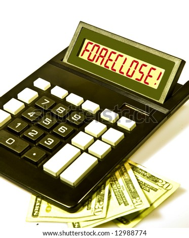 """Desktop calculator displays the word """"FORECLOSE!"""" in red  letters. - stock photo"""