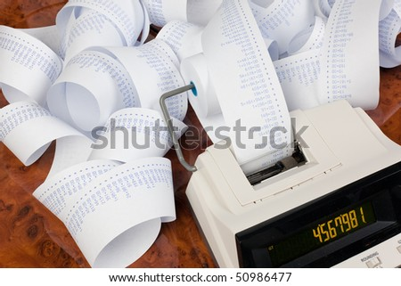 Desktop calculator with computer stripes. Icon for costs, expenses, revenues and profits. - stock photo