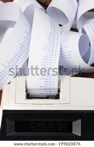 desktop calculator with computer stripes. symbol for costs, expenses, revenues and profits. - stock photo