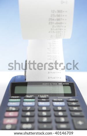 desktop calculator with paper roll - stock photo