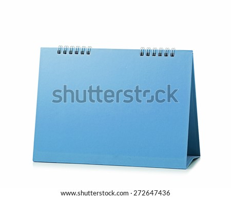 desktop calendar isolated on white background - stock photo