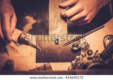 Desktop for craft jewellery making with professional tools. - stock photo