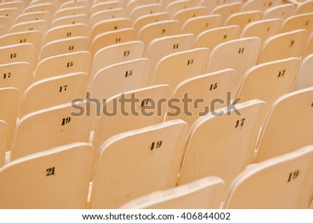 Desolate cinema chair in hall. Theater seats in movie hall - stock photo