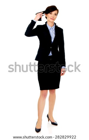 Despair businesswoman holding a gun near head. - stock photo