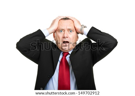 Despaired and shocked mature businessman - stock photo
