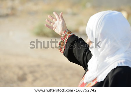Desperate Arabic woman on Middle East - stock photo