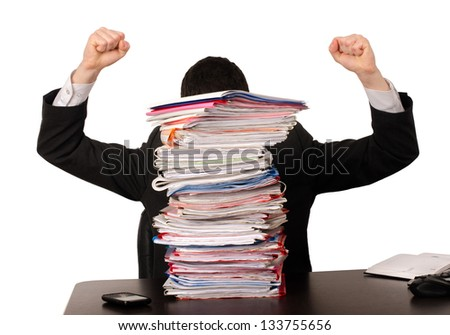 Desperate business man with a lot of work. Unhappy worker with a big pile of files to work on. Isolated on white. - stock photo