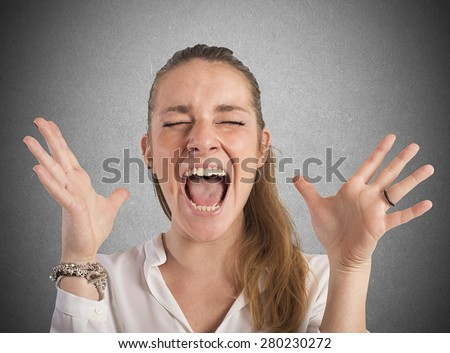 Desperate businesswoman stressed out from work screams