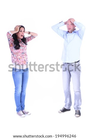Desperate couple young woman and man over white background - stock photo
