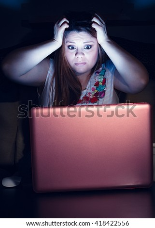 desperate girl at computer - stock photo