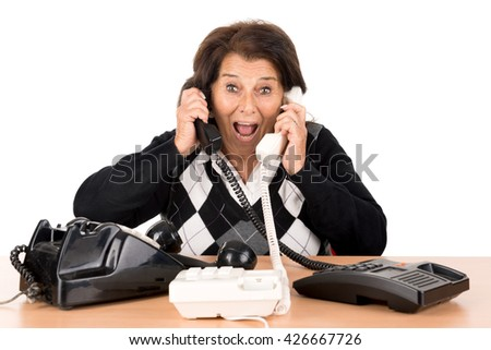 Desperate senior woman with several phones isolated in white