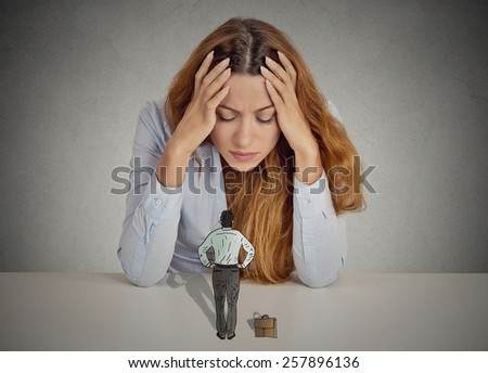 Desperate stressed business woman leaning on a desk small bossy executive man patronizing her. Negative human emotions face expression feelings life perception - stock photo