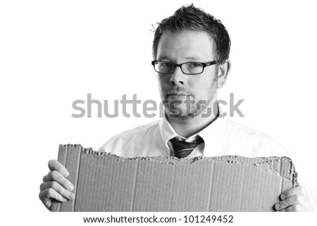 Desperate - This is a high contrast black and white image of a desperate businessman holding a black cardboard sign. Shot on a white background. - stock photo