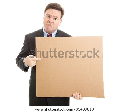 Desperate, unemployed businessman holding up a message on a cardboard box.  Blank for your text. - stock photo