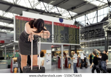 desperate woman at the airport / airport