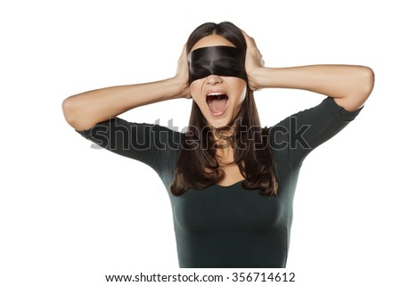 desperate young blindfolded woman screaming - stock photo