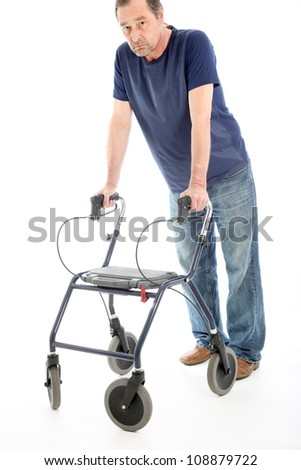 Despondent man leaning on medical walker Despondent man facing the camera leaning heavily on a medical walker for support isolated on white